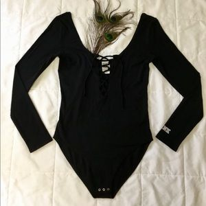 Vs Pink, black scoop neck, lace up bodysuit